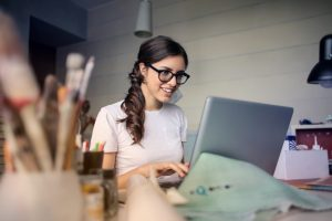 a woman using a laptop to find a certified SEO company