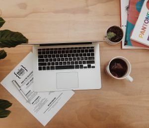 coffee and laptop are common tools in a desktop in blog writing