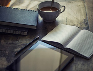 Books, a tablet, and a cup of coffee