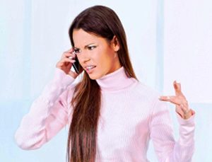 female in pale pink turtle neck sweaters complaining over the phone