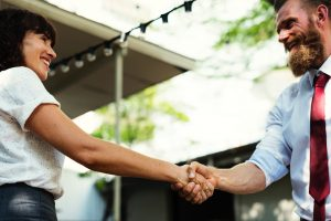 Virtual Assistant says thank you by shaking hands of client