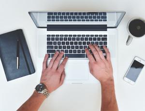 hands, coffee, MacBook, pen, black notebook
