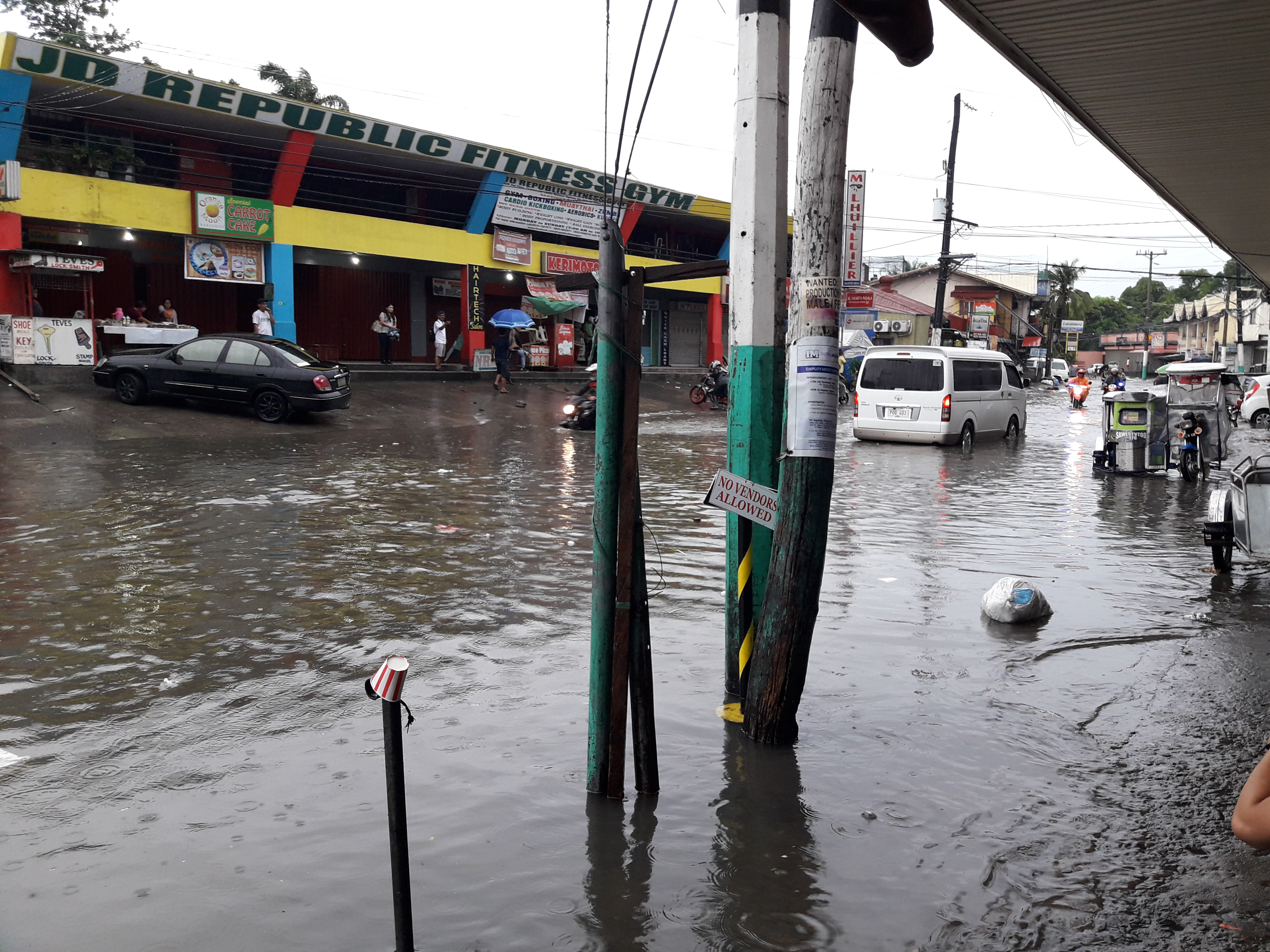Flood Along Maharlika Drive - Photo Courtesy of Menard Duria