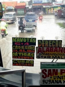 Bus braves the flooded streets in San Pedro Laguna