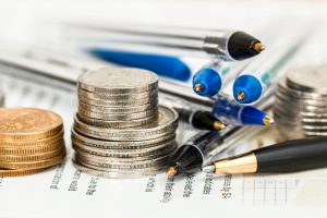 coins and ballpens to use with money saving tips for employees