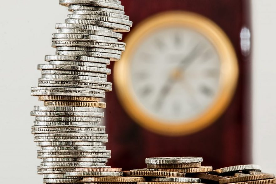 Budgeting Tips: Coins with Clock on the Background