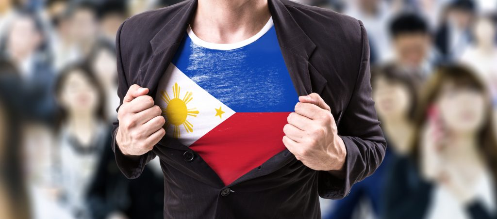 labor force trends A guy opening his suit to show Filipino flag inspired t-shirt