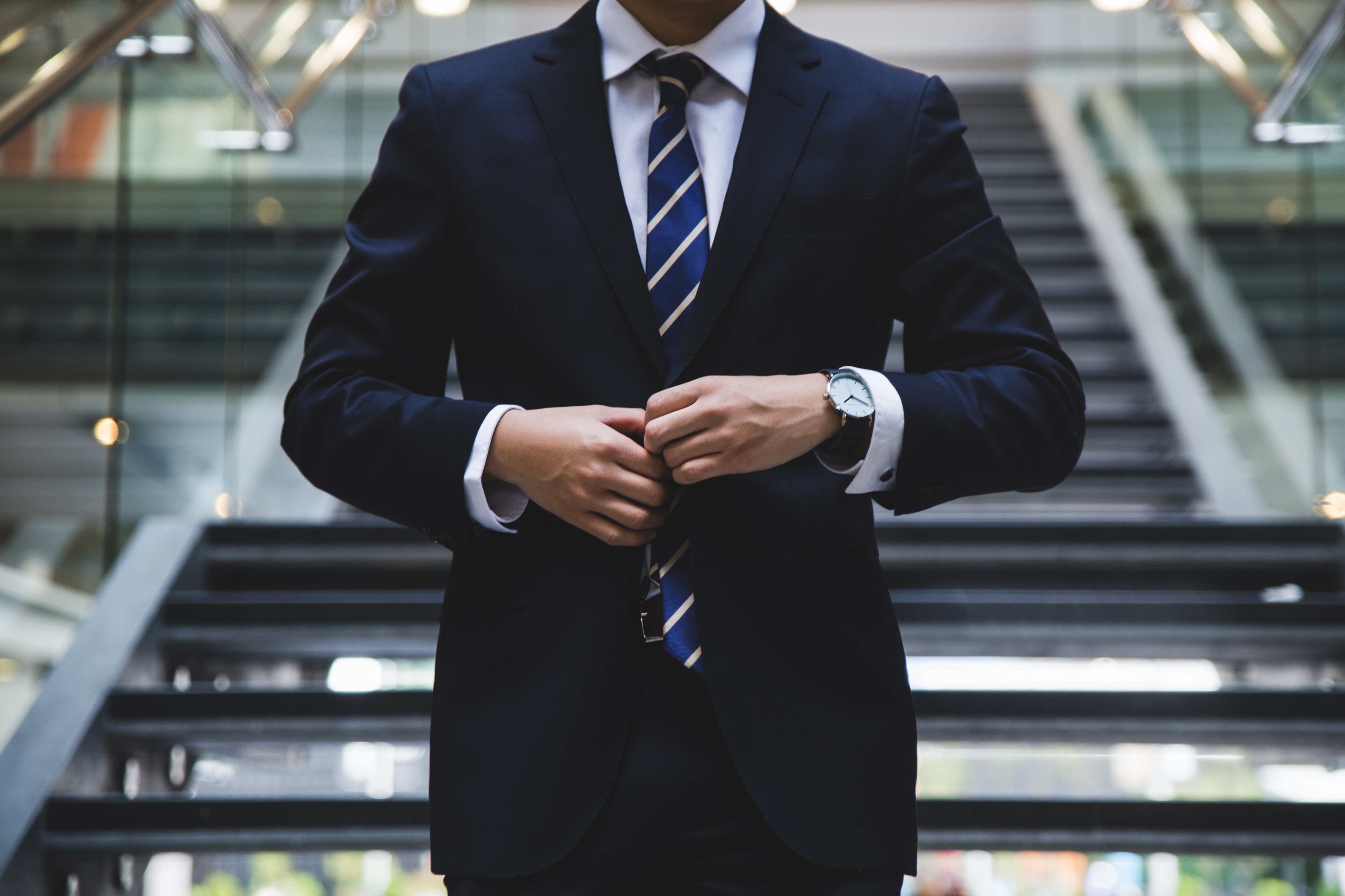 corporate ethics for gen Z torso of a man in a suit