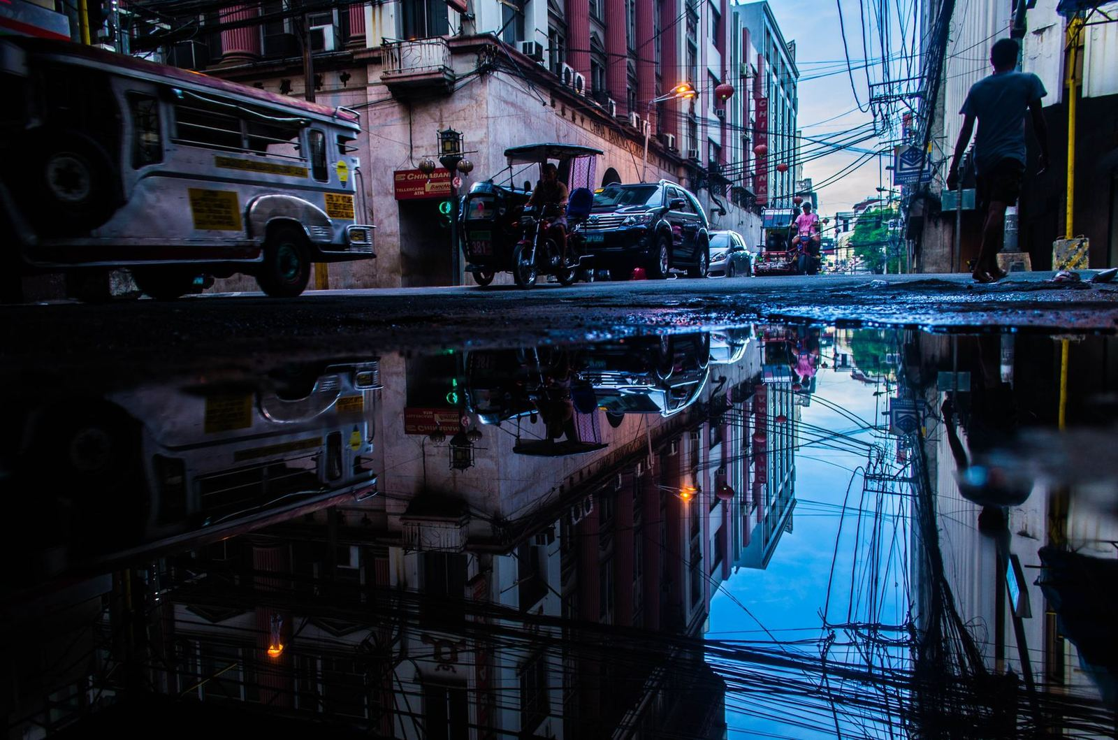philippine federalism reflection of a street in the philippines in a puddle