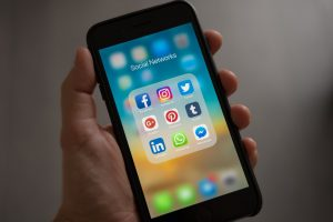 holding a phone and appreciating the social media marketing importance