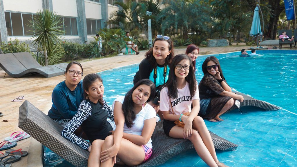 Female employees pose for a photo op in the FilWeb Asia in 2018 summer getaway