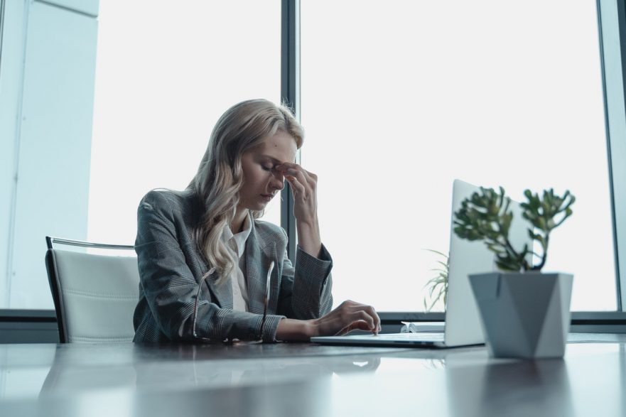 professional woman burned out at work due to no work-life balance