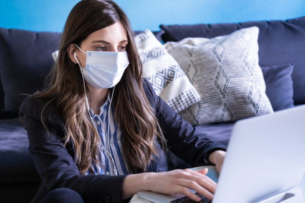 Woman using her laptop for career planning amid the COVID-19 pandemic.