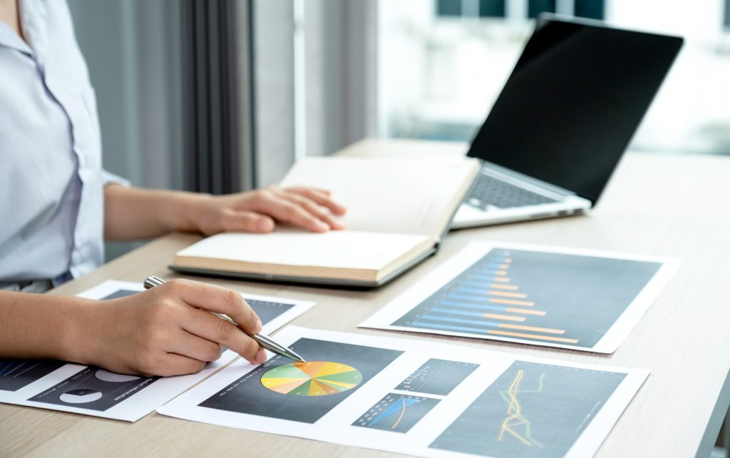 businesswoman analyzing how measurable the goals are